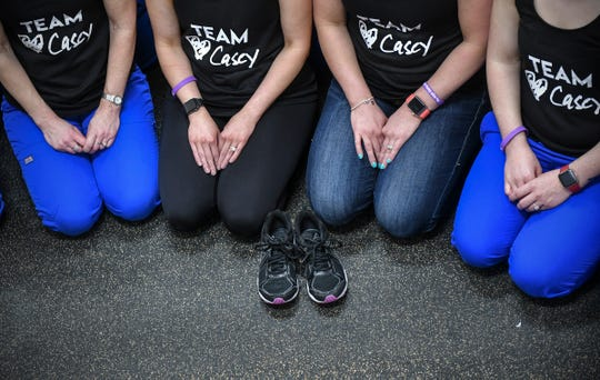 Casey Myers' running shoes are treasured by her friends and co-workers who plan to honor her memory by participating in Earth Day Run activities this weekend.
