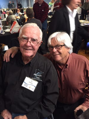 Founder of the Minnesota Fishing Museum Al Baert, left, visits with Mike Gettisat the annual fundraiser in Little Falls.