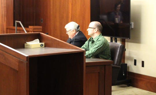 From left, defense attorney Edward Flint and Kevin Mcatlin listen to witness testimony on Tuesday.