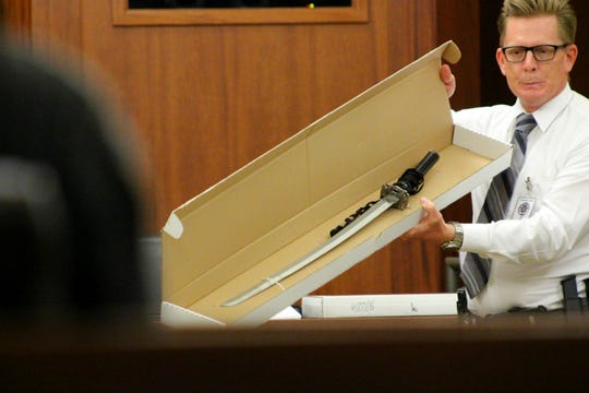 Joshua Wilson, St. George Police Department detective, displays a katana sword to the jury in the Kevin Mcatlin case on Tuesday.