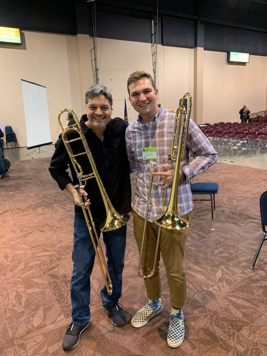 Tanner Deal, right, a Dixie State University music major, poses with professional trombone player Domingo Pagliuca from the Boston Brass during a master class at a Utah Music Educators Association brass ensemble event on Feb. 2, 2019.