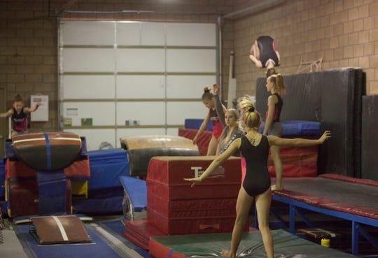 Gymnasts train at Champion Gymnastics Thursday, April 11, 2019.