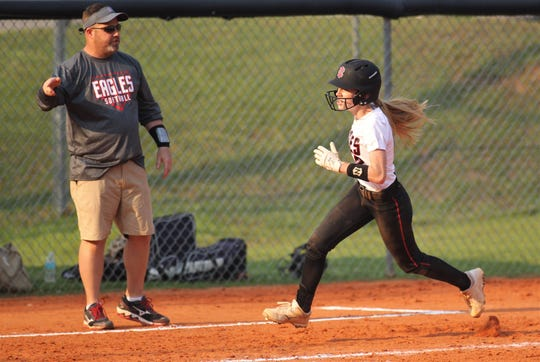 NFC eighth-grader Maddie Mayo rounds third to score the game-ending run at coach Dennis Gorham's direction as NFC beat Aucilla Christian 15-5 on Tuesday, April 16, 2019.