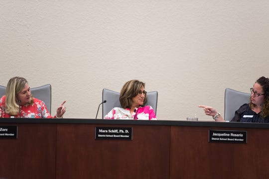 Indian River County School Board Chair Laura Zorc (left) and School Board member Jacqueline Rosario (right) exchange points past fellow member Mara Schiff, Ph. D., during a special meeting at district offices Tuesday, April 16, 2019, to discuss Superintendent Mark Rendell's offer for a negotiated end to his employment.