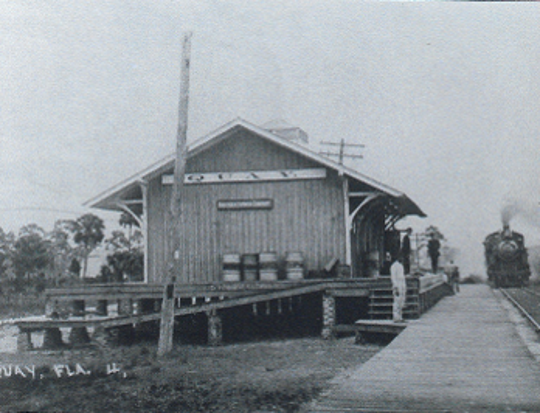 The Hamilton-Mathis families grew green beans on what is now John's Island. They loaded crates on to launches at Quay Dock which were carried across the Indian River Lagoon to the Quay Depot. A train then picked up the crates for shipping.