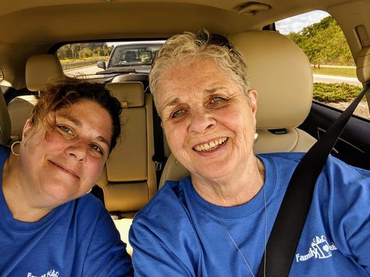 Volunteer drivers Jennifer and Martha Phelps helped deliver more than 2,000 meal bags for the Family Meals Easter Outreach.