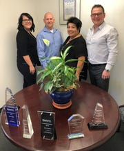 Pictured from left with Force Logistics are Ashley Walsh, Tim Covey, Tina Borja and Mark Cason. The company received the Platinum Award from Matson for the sixth consecutive year.