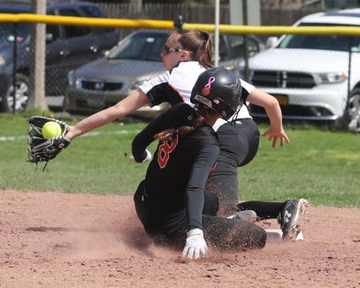 Alexa Galligani of White Plains steals second base as Mamaroneck's Caleigh Shapiro takes the late throw during a varsity softball game at Mamaroneck April 17, 2019. White Plains defeated Mamaroneck 16-0.
