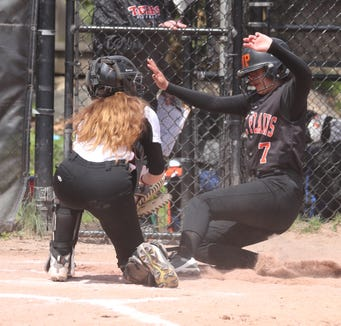 Evelyn Flores of White Plains is tagged out at home by Mamaroneck's Nora O'Brien during a varsity softball game at Mamaroneck April 17, 2019. White Plains defeated Mamaroneck 16-0.