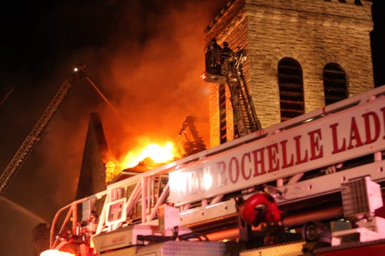 New Rochelle firefighters battle a February 2011 five-alarm fire that destroyed the Union Baptist Church on Main Street in New Rochelle. The church is planning to rebuild on its original site, and add affordable apartments.