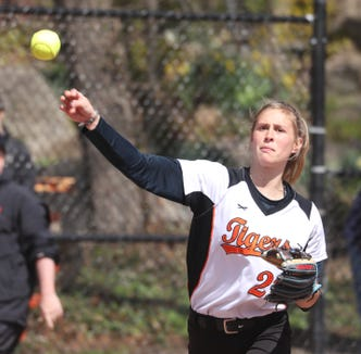 Pitcher Tava Kasper of Mamaroneck throws to first base during a varsity softball game against White Plains at Mamaroneck April 17, 2019. White Plains defeated Mamaroneck 16-0.