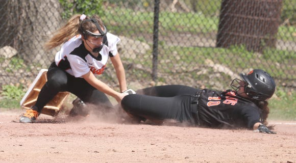 Ava Rainone of White Plains is safe at third as base as Mamaroneck's Maddie Silverstein applies the late tag during a varsity softball game at Mamaroneck April 17, 2019. White Plains defeated Mamaroneck 16-0.