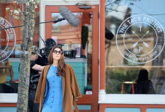 """Actress Marisa Tomei shoots a scene for """"Human Capital"""" on Main Street in Tarrytown April 17, 2019. Liev Schreiber also stars in the film, which is an adaptation of Stephen Amidon's 2005 novel about families who collide as they chase the American dream."""