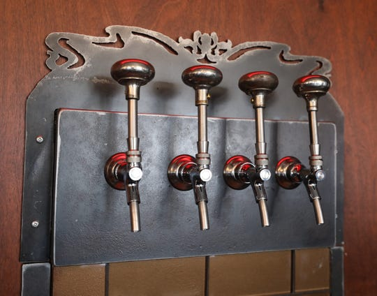 Hand crafted stainless steel beer taps made from doorknobs by artist Cal Lane, at the Tapsmith in Croton, a new beer and bar food establishment in Croton-on-Hudson, photographed April 17, 2019.