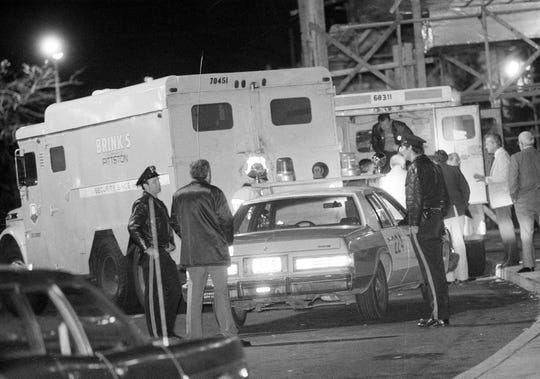 Police are at the scene of a Brinks armored truck after a robbery at the Nanuet Mall in Nanuet, N.Y., early Wednesday morning, Oct. 21, 1981. Two Nyack police officers and a Brinks guard were killed during robbery.