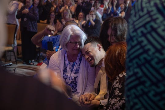 James Elliott cries while embracing his mother Robin earlier this month after  being elected as the international president of Phi Theta Kappa during the honor society's annual convention in Orlando, Florida.