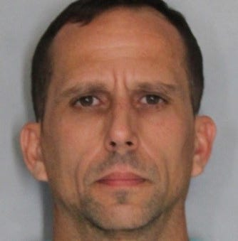 Delaware City man hit neighbor with shovel and bit him, police say