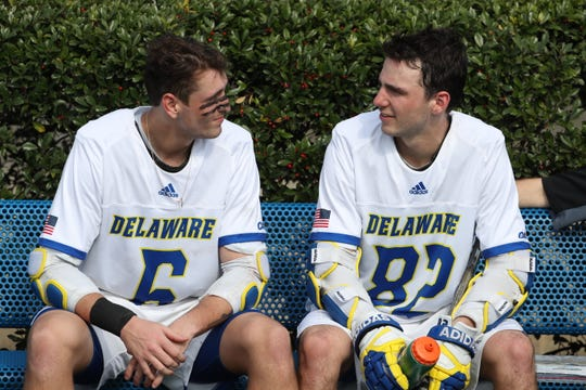 Delaware's Tye Kurtz (right) sits with Charlie Kitchen after Delaware's 13-7 win against Hofstra at Delaware Stadium.