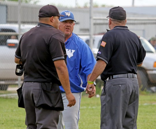 Windthorst's Scott Belcher is in his second year coaching Cy on the Trojans' varsity baseball team.
