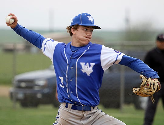 Windthorst's Cy Belcher pitches against Archer City Tuesdsay, April 16, 2019, in Windthorst. The Trojans defeated the Wildcats 2-1 in the second game of the doubleheader.