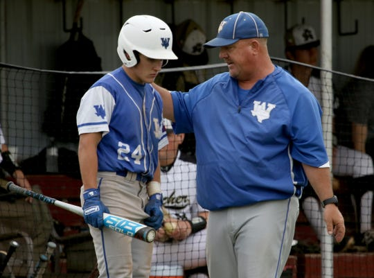 Windthorst head baseball coach Scott Belcher talks with Tryston Harding during a timeout in the game against Archer City Tuesday, April 16, 2019, in Archer City. The Trojans defeated the Wildcats 4-3 in the first game of the doubleheader.