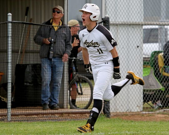 Archer City's Justin Browning celebrates his 2-run homerun against Windthorst Tuesday, April 16, 2019, in Archer City. The Trojans defeated the Wildcats 4-3 in the first game of the doubleheader.