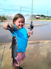 In this picture from a couple years ago, River Lang shows off a catfish she caught at South Weeks Pond.