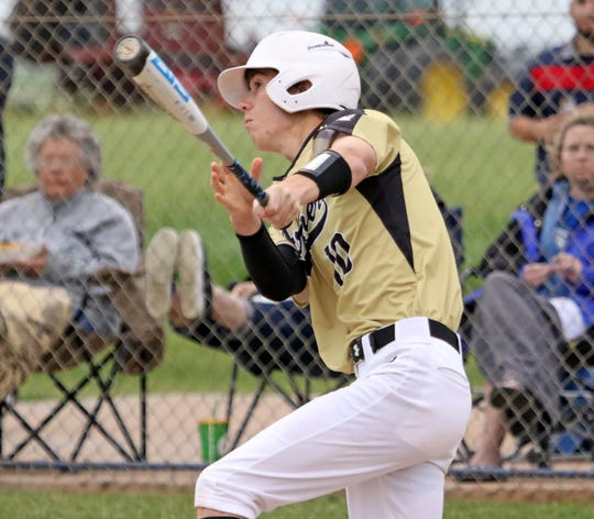 Archer City's Connor Byrd hits a flyball against Windthorst Tuesdsay, April 16, 2019, in Windthorst. The Trojans defeated the Wildcats 2-1 in the second game of the doubleheader.