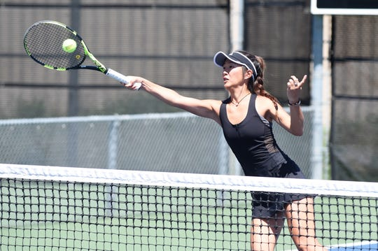 Rider's Julia Chon returns the ball Wednesday during the Region I-5A mixed doubles quarterfinals in Lubbock.