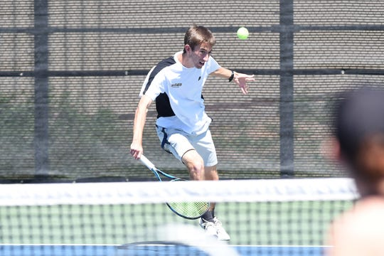 Rider's Chris Selsor charges the ball Wednesday during the Region I-5A mixed doubles quarterfinals in Lubbock.