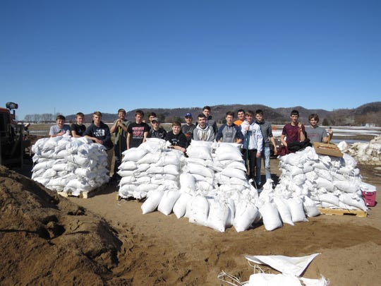 FFA members fill sandbags in an effort to help communities impacted by the spring flooding.