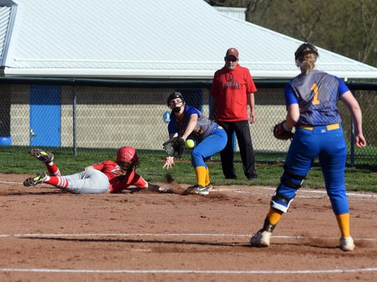 Sheridans' Makayla Sheridan dives into first base ahead of Katie Pride's tag during the Generals' 6-1 win against Philo.