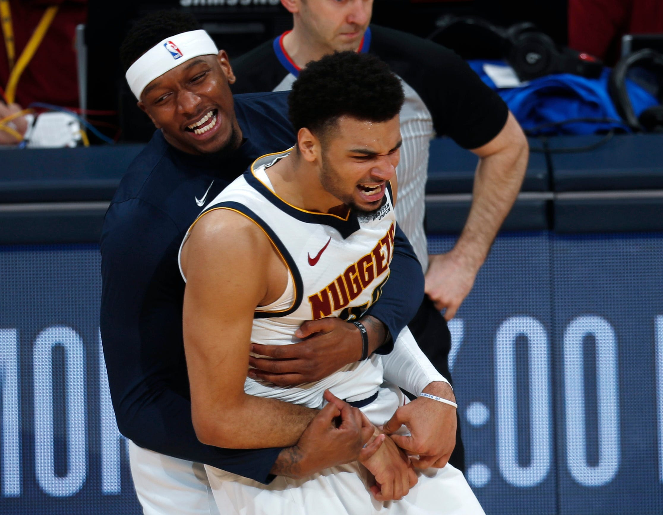 April 16: Nuggets forward Torrey Craig hugs Jamal Murray after he hit a shot late in Denver's Game 2 win over the Spurs.