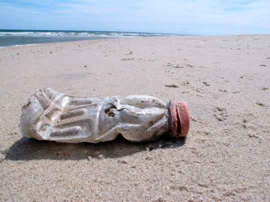 A discarded plastic bottle lies on the beach at Sandy Hook, N.J. on April 2, 2019, the same day as a report released by the environmental group Clean Ocean Action found that volunteers picked up more than 450,000 pieces of litter from New Jersey's coastline last year.