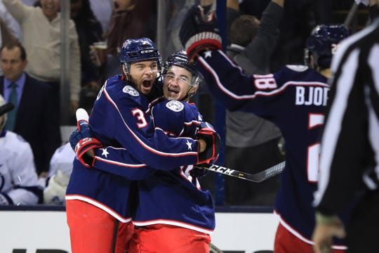 Seth Jones celebrates a Blue Jackets goal with teammates in Game 4.
