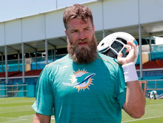 Miami Dolphins quarterback Ryan Fitzpatrick walks off the field during voluntary minicamp at the Miami Dolphins football training facility, Tuesday, April 16, 2019, in Davie, Fla.