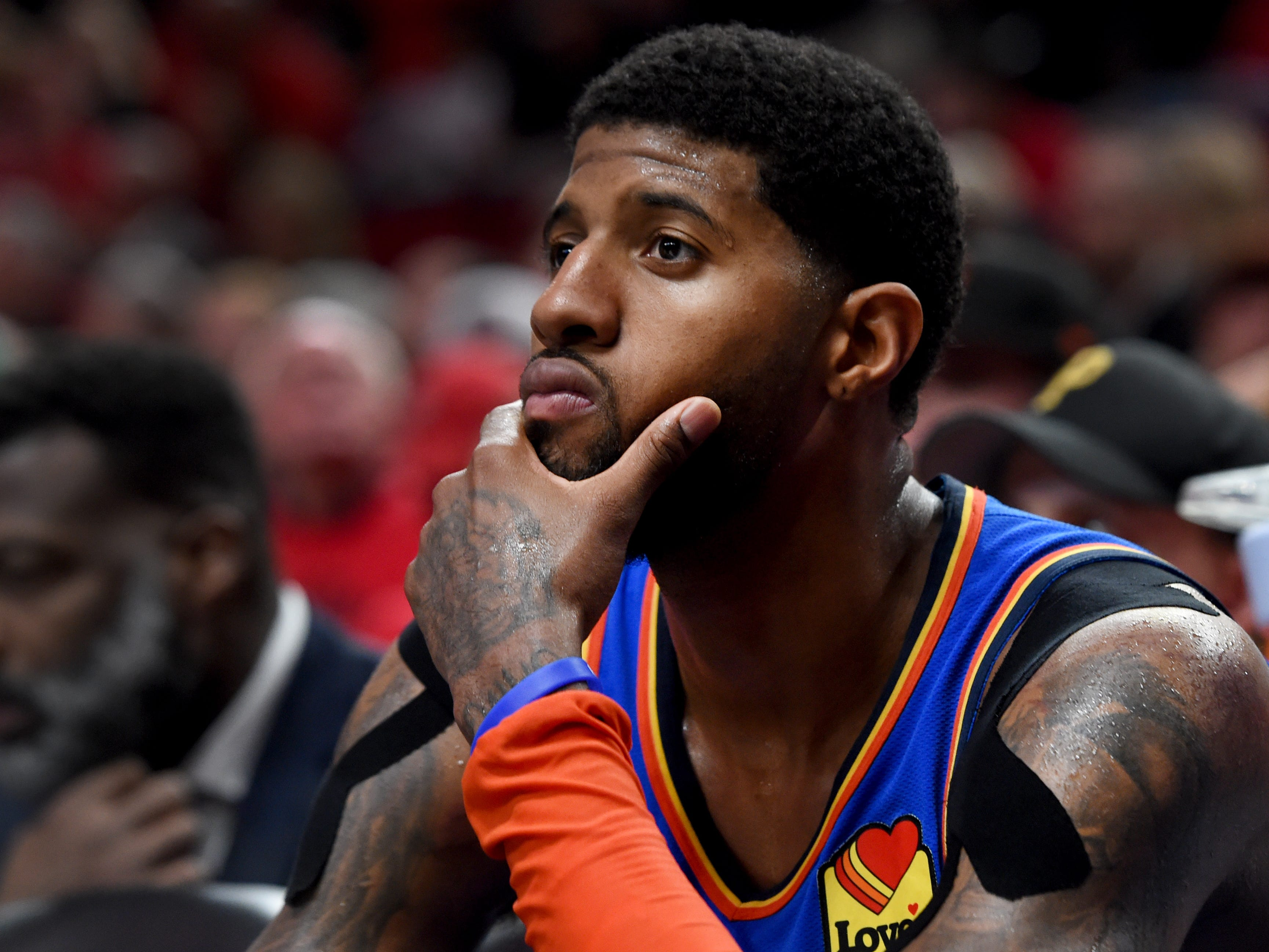 April 16: Paul George watches from the bench as time winds down during the Thunder's Game 2 loss to the Trail Blazers.