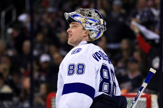 Tampa Bay Lightning goaltender Andrei Vasilevskiy looks to the video board during a stop in play in Game 3.