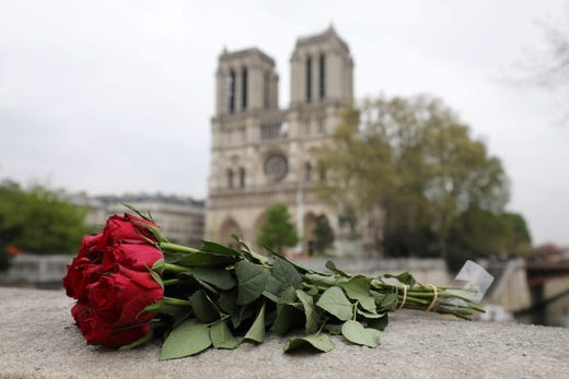 A bouquet of rose is seen outside the cathedral on April 16, 2019.