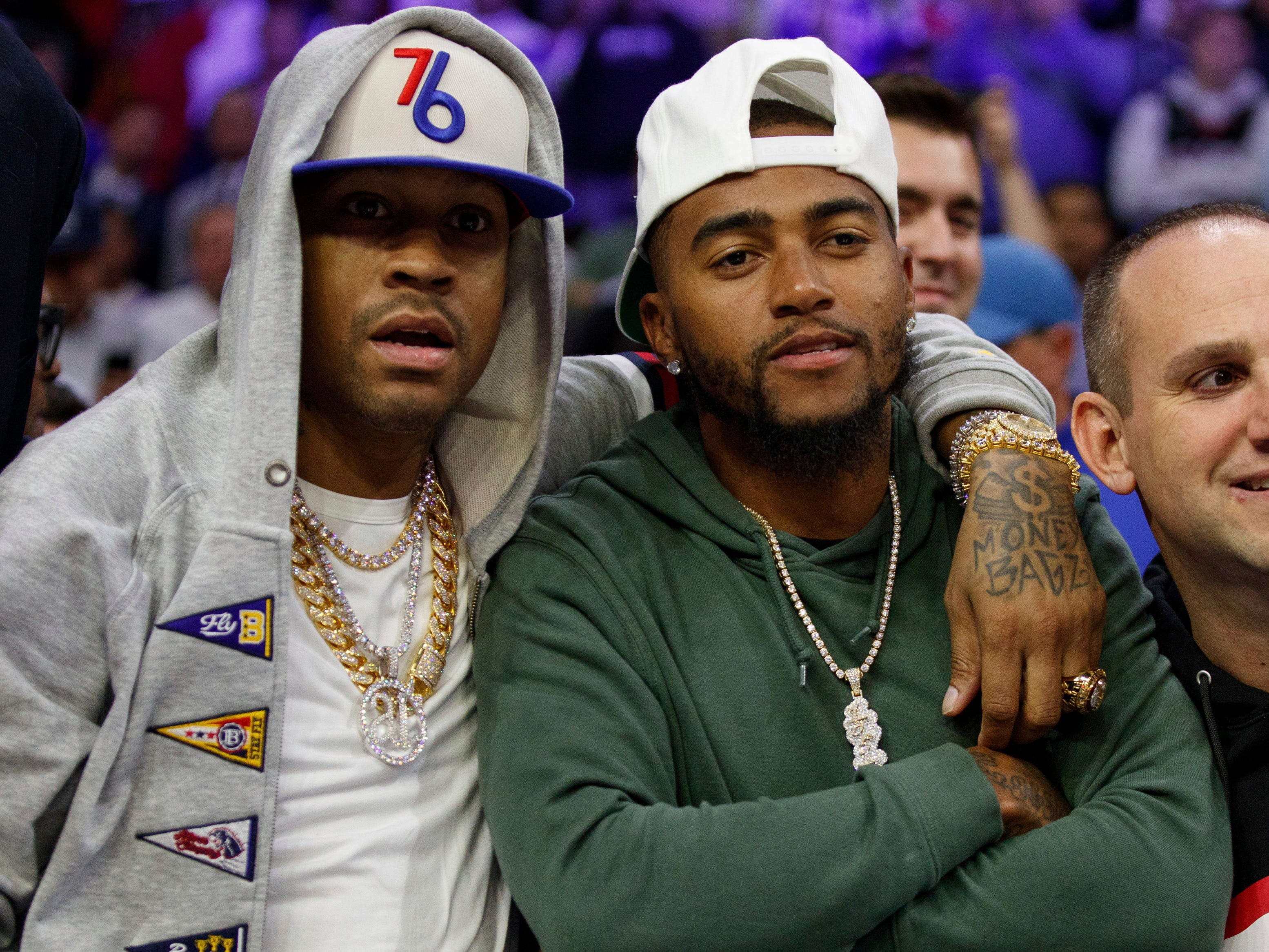 April 15: Former 76er Allen Iverson, left, poses with Eagles receiver DeSean Jackson during the second half of Game 2 against the Nets in Philadelphia.