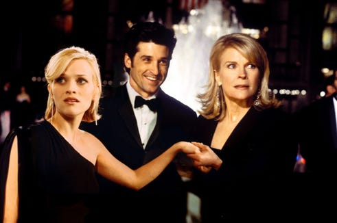 In the 2002 film, Reese Witherspoon's character gets engaged to Patrick Dempsey's, much to the dismay of his mother played by Candice Bergen.