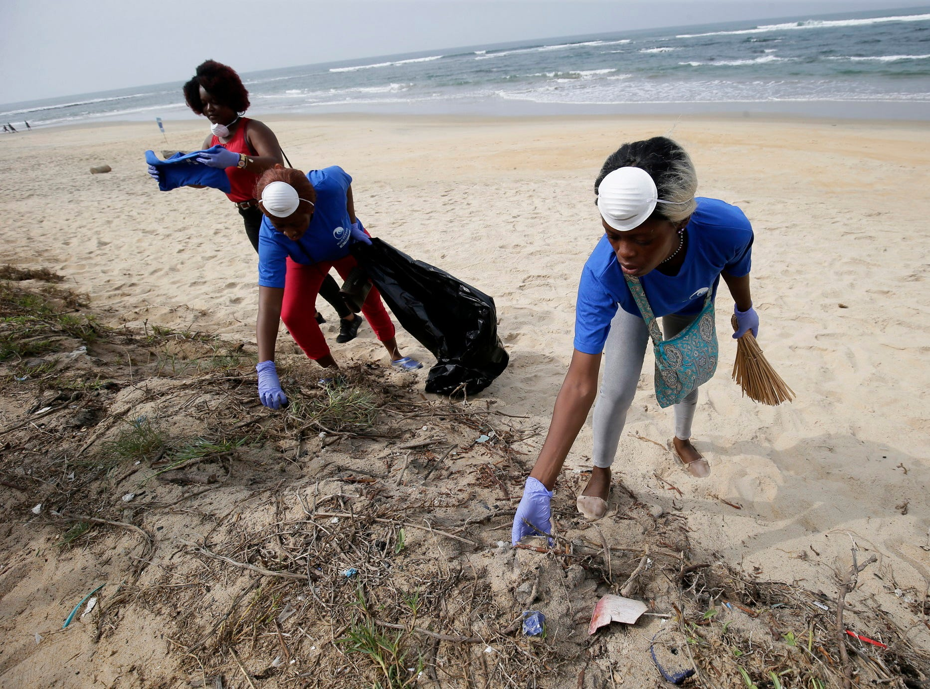 Participants pick up plastic waste on Snow beach in Paynesville City, outside Monrovia, Liberia March 18, 2019.