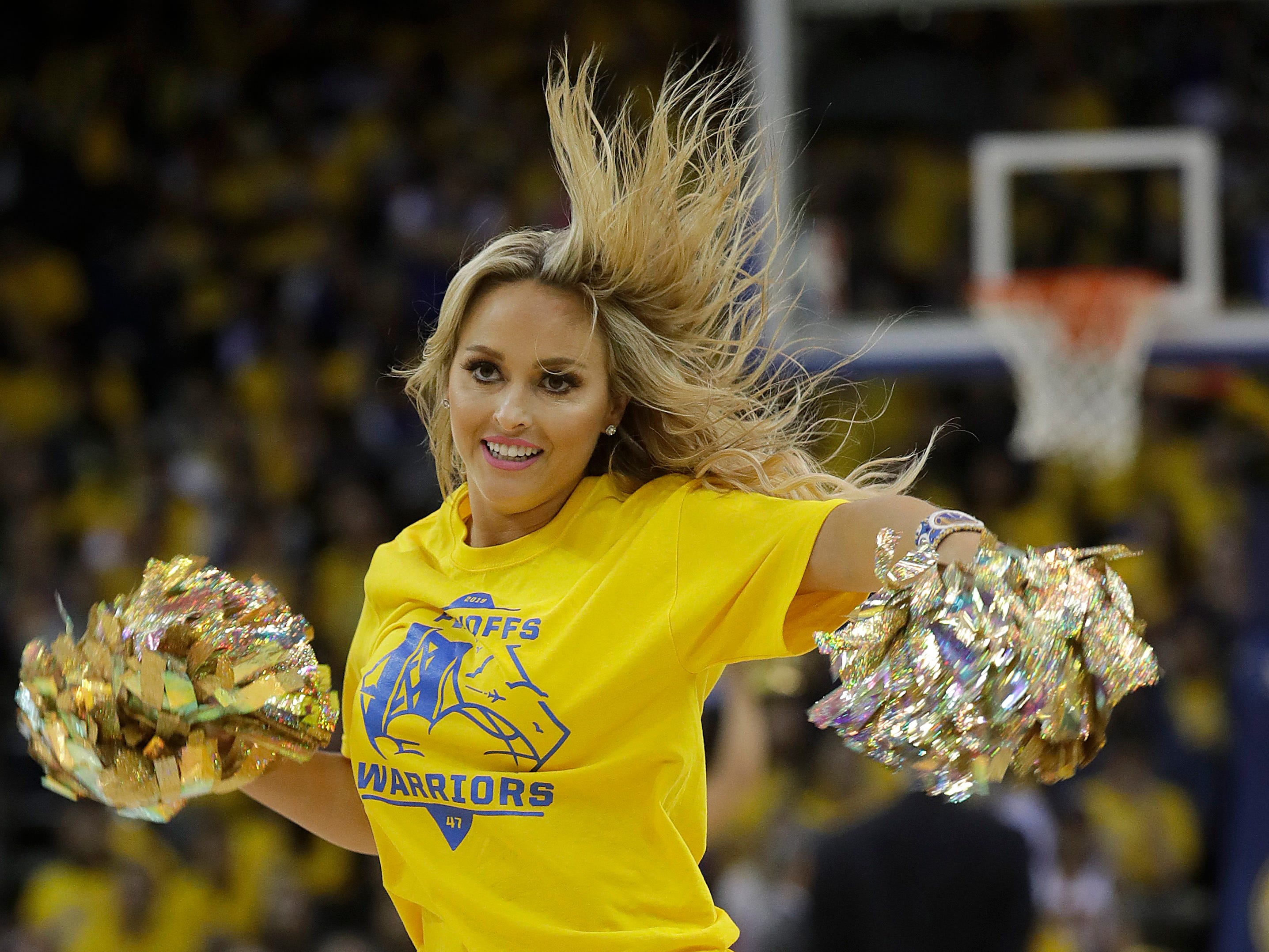 April 15: A Warriors cheerleader performs during the second half of Game 2 against the Clippers.