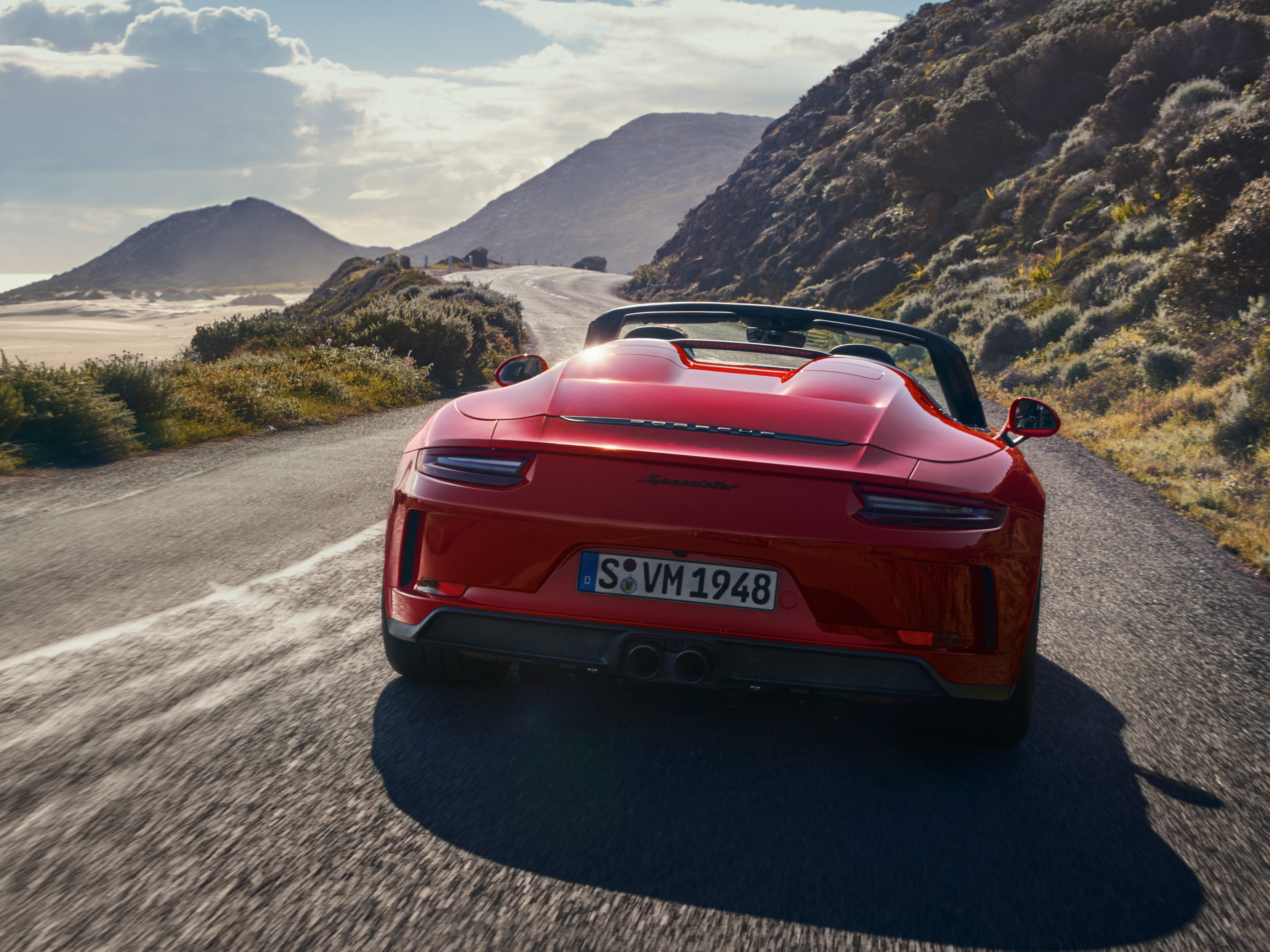 The sportscar's bodyshell is based on the 911 Carrera 4 Cabriolet with its hood and fenders made of carbon fiber. And the chassis was taken from the 911 GT3. Porsche says its red paintwork is a reference to the 1988 911 Speedster of the G-Model generation. Porsche's 911 Speedster will be on display at the New York Auto Show.