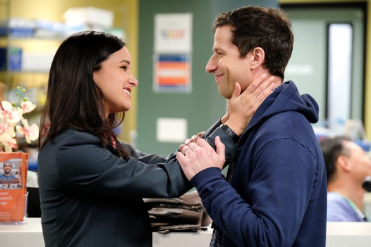 Amy Santiago (Melissa Fumero), left, and Jake Peralta (Andy Samberg) are married police colleagues on NBC's 'Brooklyn Nine-Nine.' (Photo: John P. Fleenor, NBC)