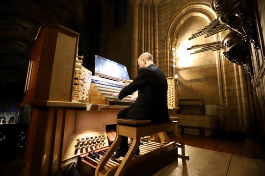 Johann Vexo, an organist at Notre Dame Cathedral, says he thought it had to be a mistake when fire alarms sounded.