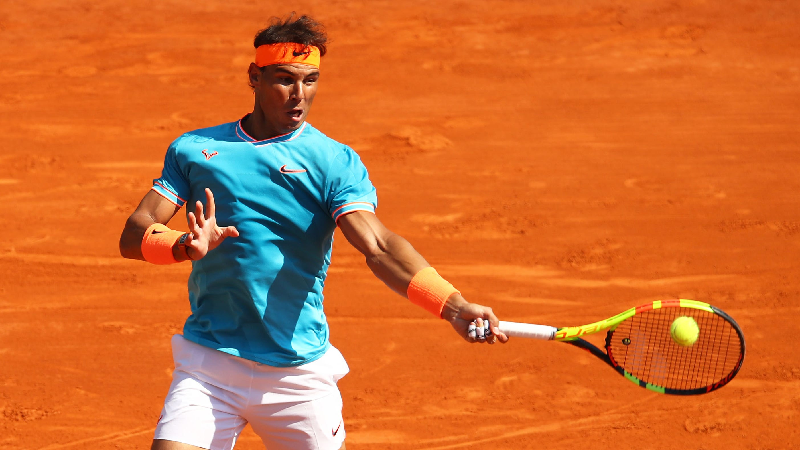Rafael Nadal of Spain plays a forehand against Roberto Bautista Agut of Spain in their second-round match at the Monte Carlo Masters.