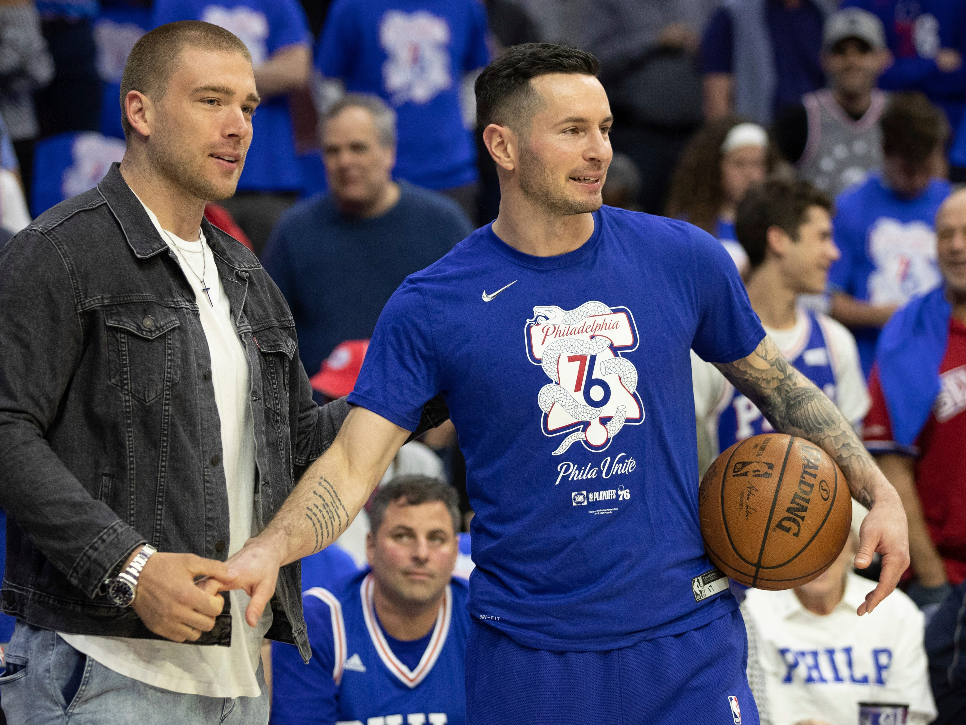 April 13: 76ers guard JJ Redick, right, talks with Eagles tight end Zach Ertz prior to the first half of Game 1 against the Nets in Philadelphia.