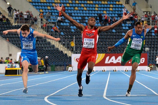 Noah Lyles celebrates victory in the 100-meter final while the 2016 IAAF World U20 Championships in Bydgoszcz, Poland.