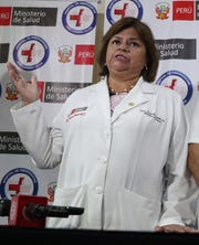 Health Minister Zulema Tomas speaks at a news conference at the Casimiro Ulloa hospital where former Peruvian President Alan Garcia was taken after he shot himself, in Lima, Peru, Wednesday, April 17, 2019. Peru's Health Ministry said Garci­a was sent to the hospital at 6:45 a.m. local time for a bullet wound  (AP Photo/Martin Mejia)
